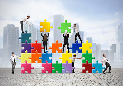 people building puzzle together